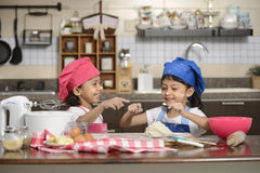 Two Little Girls Make Pizza Royalty Free Stock Images