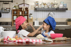 Two Little Girls Make Pizza Stock Images