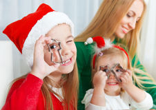 Two little girls with mother baking Christmas cookies Stock Photography