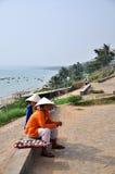 Two little girls in Mui ne fishing village. Two little girls were selling their souvenir in mui ne fishing village stock image