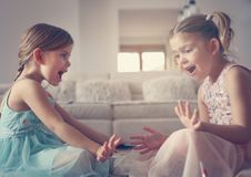 Sisters painted nails together. Two little girls. Two little girls nailed their nails at home. Close up image Stock Photos