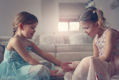 Sisters painted nails together. Two little sisters. Two little girls nailed their nails at home. Little sisters doing nails Stock Image