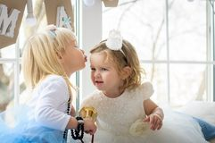 Two little girls in the New Year at the window royalty free stock photo