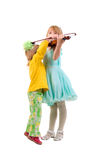 Two Little Girls And One Violin. Stock Photography