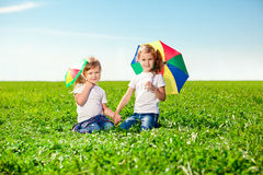 Two little girls  in outdoor park  at sunny day. Sisters in the Royalty Free Stock Photos