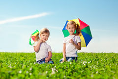 Two little girls  in outdoor park  at sunny day. Sisters in the Royalty Free Stock Images