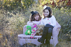 Two little girls outdoors Royalty Free Stock Photo