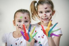 Happy and smiling little girls. stock image