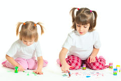 Two little girls painting Stock Photography