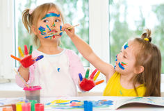 Two little girls painting Stock Images