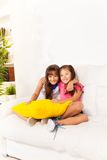 Two little girls with pillows Royalty Free Stock Images