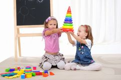 Two little girls play Stock Photography