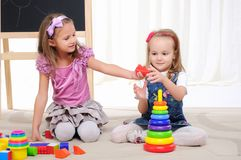 Two little girls play. With friends and have fun Royalty Free Stock Images