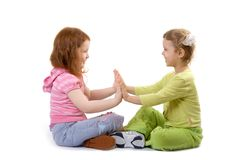 Two little girls play. Isolate over white Royalty Free Stock Photography