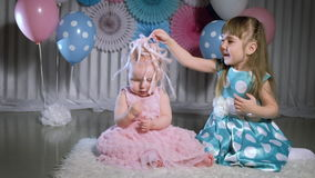 Two little girls play. Two cute girls with stethoscope isolated on white stock video footage