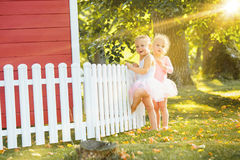 The two little girls at playground against park or green forest Stock Image