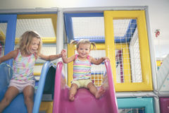 Two little girls in playground. Stock Photography