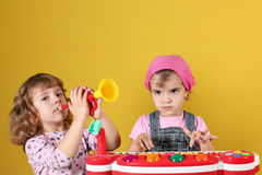 Two little girls playing Royalty Free Stock Image