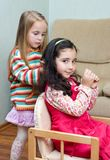 Two little girls playing Royalty Free Stock Photo