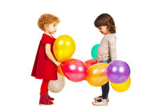 Two little girls playing with balloons Stock Image