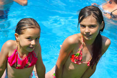 Two little girls playing in the bassin Stock Photo