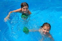Two little girls playing in the bassin Royalty Free Stock Photography