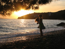 Two little girls playing on beach. In sunset, Tucepi, Croatia, Adriatic sea Royalty Free Stock Photography