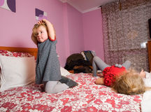 Two little girls playing on the bed Royalty Free Stock Photo