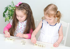 Two little girls playing domino Stock Photography