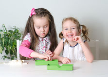 Two little girls playing domino Stock Photos