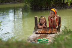 Two little girls playing in the farm lake Royalty Free Stock Photography