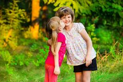 Two little girls playing fly in summer park. Concept of family. stock photo