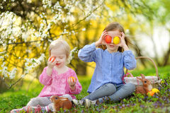 Two little girls playing in a garden on Easter Royalty Free Stock Photos