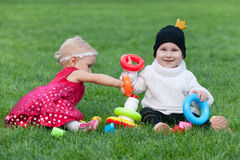 Two little girls playing on the grass Stock Image