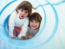 Two little girls playing in kindergarten Stock Image