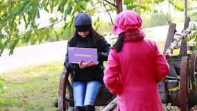 Two little girls playing on laptop. Sisters have a fun time on laptop. Autumn stock video footage