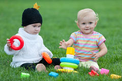 Two little girls are playing outdoor Stock Photo