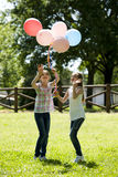 Two little girls playing outdoors Stock Photography