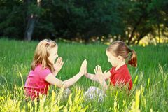 Two little girls playing patty-cake Royalty Free Stock Image