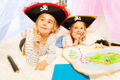 Two little girls playing pirates at imagine ship. Two little girls in three-corned hats, playing pirates at imagine ship royalty free stock image