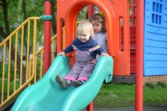 Two little girls playing on  playground Royalty Free Stock Images