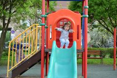 Two little girls playing on  playground Royalty Free Stock Photos