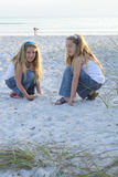 Two little girls playing in the sand. Shot of two little girls playing in the sand Royalty Free Stock Photo