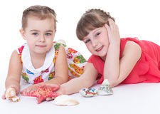 Two little girls are playing Stock Image