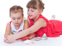 Two little girls are playing Stock Images