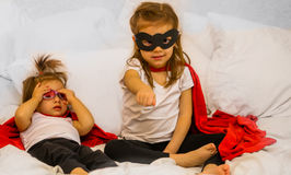 Two little girls playing super hero Royalty Free Stock Photography