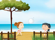 Two little girls playing volleyball at the beach Stock Photo