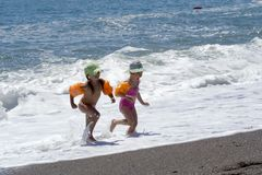 Two little girls plays at the seaside Royalty Free Stock Image