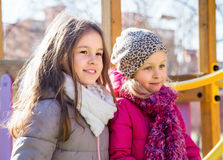 Two little girls posing at playground Royalty Free Stock Images