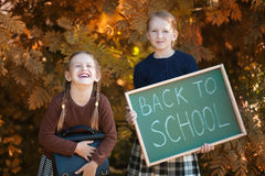 Two little girls ready back to school Stock Photo